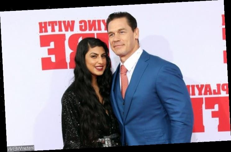 John Cena and Shay Shariatzadeh Posing Outside Courthouse After Obtaining Marriage License