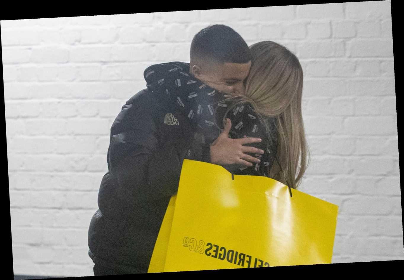 Katie Price hugs son Junior after hitting Selfridges in orthopaedic boots for late-night shopping spree