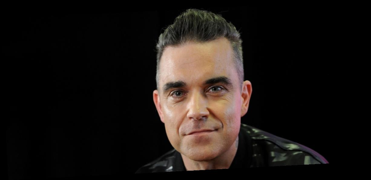 Singer Robbie Williams Says He Almost Died From Eating Too Much Fish