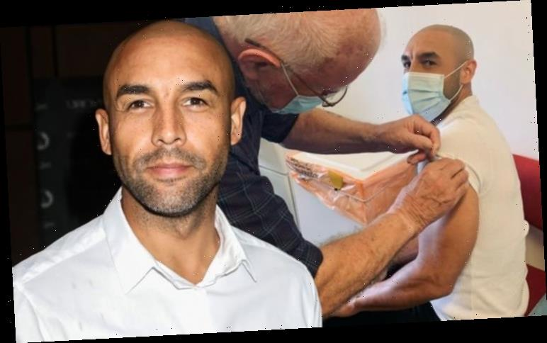 Alex Beresford quips 'I know I don't look old enough' as he gets Covid vaccine
