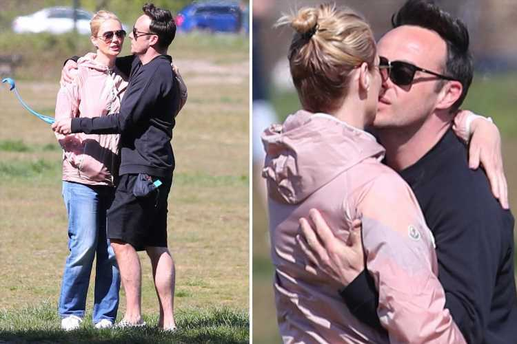 Ant McPartlin and fiancée Anne-Marie kiss as they walk their dogs in the sunshine in Wimbledon