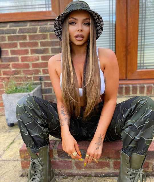 Jesy Nelson flashes toned midriff and cleavage in a sexy crop top and army fatigue trouser combo on another night out
