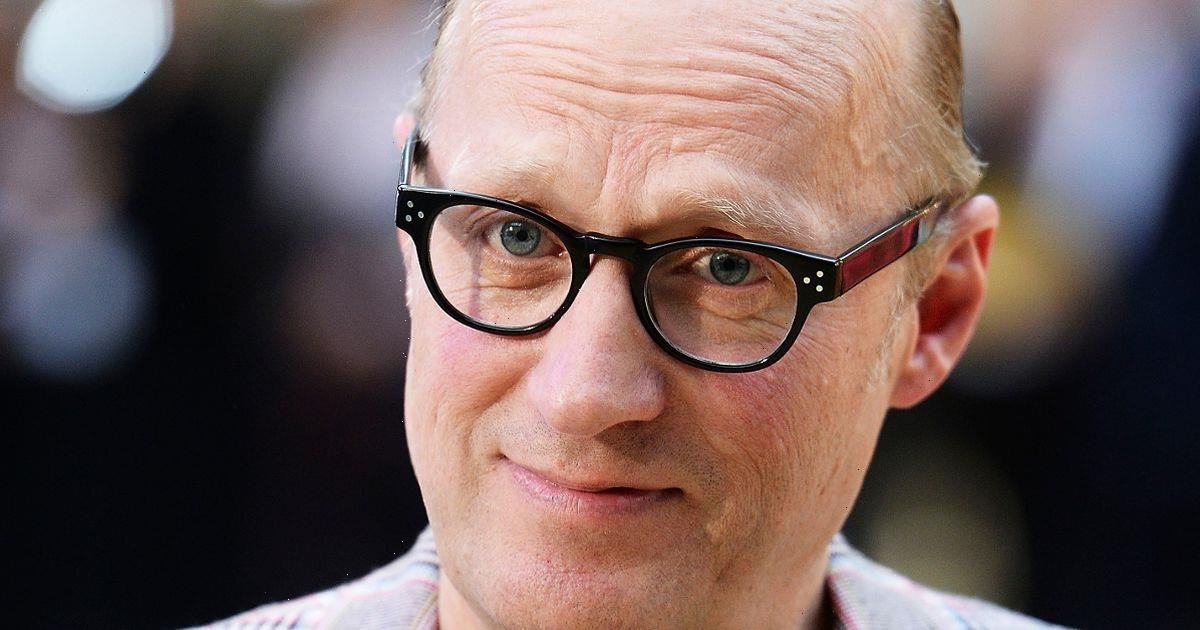 Comedian Ade Edmondson rescued by fire brigade after getting stuck on ledge